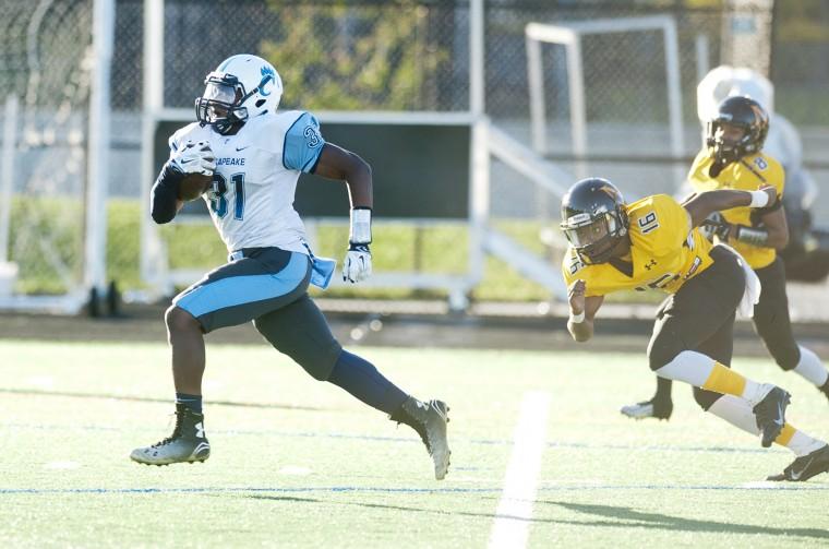 Chesapeake's Quentin Ford runs in a touchdown in the game at Northeast. (Joshua McKerrow/Capital Gazette)