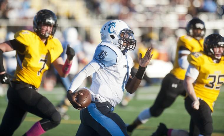 Chesapeake's Rashawn Shields runs the ball in the game with Northeast. (Joshua McKerrow/Capital Gazette)