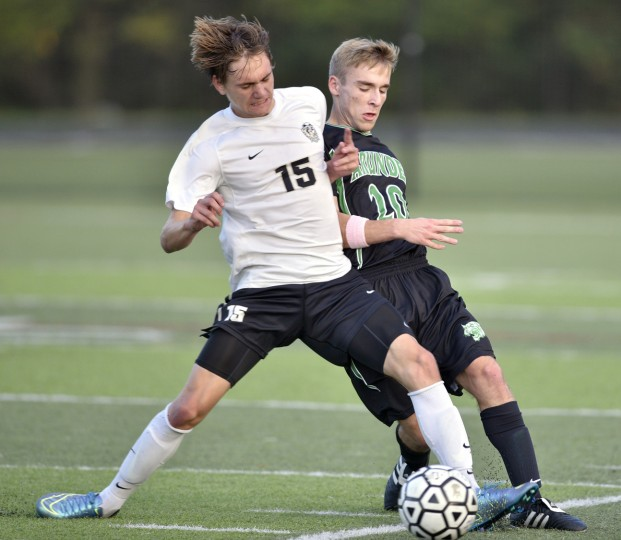 Meade's Samuel Solomon takes possession from Arundel's Andrew Wick during Tuesday nights game at Meade High School. (Matthew Cole/Capital Gazette)