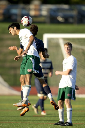 Glenelg Country School's Moosa Hira gets up for the header during the second half of the boys soccer game against Chapelgate at Glenelg Country School in Ellicott City, MD on Wednesday, October 14, 2015. (Jen Rynda/BSMG)