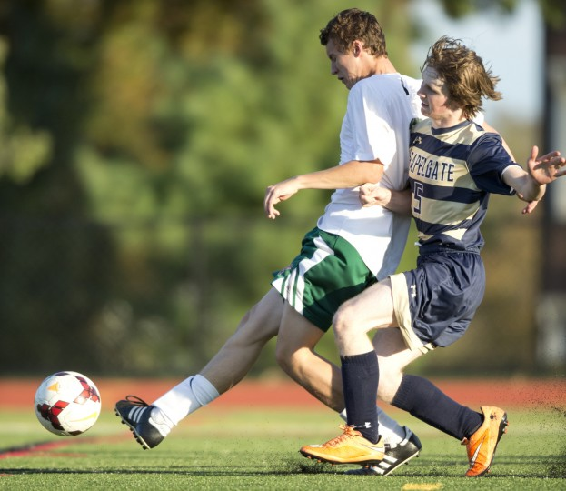 Glenelg Country School's Aidan Wisely, left, gets the ball past Chapelgate's Daniel Butler to shoot and score during the second half of the boys soccer game at Glenelg Country School in Ellicott City, MD on Wednesday, October 14, 2015. (Jen Rynda/BSMG)
