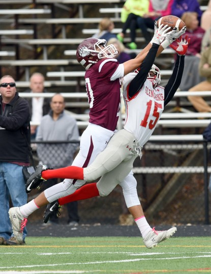 Broadneck wide receiver Robert Schwob, left, pulls in a tough catch between the hands of Glen Burnie's DJ Brent in the third quarter.  The Broadneck Bruins defeated the visiting Glen Burnie Gophers, 41-20, in high school football Saturday afternoon. (Paul W. Gillespie/Capital Gazette)