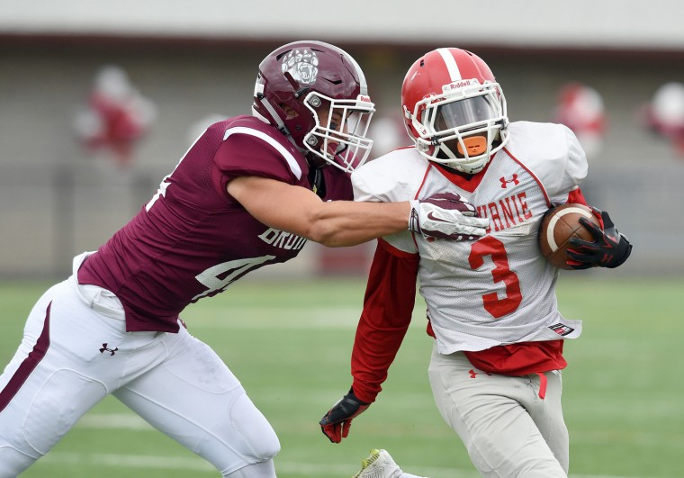 Glen Burnie's Taylor Johnson, right, slips the tackle of Broadneck's George Shively on a run in the second quarter. The Broadneck Bruins defeated the visiting Glen Burnie Gophers, 41-20, in high school football Saturday afternoon. (Paul W. Gillespie/Capital Gazette)