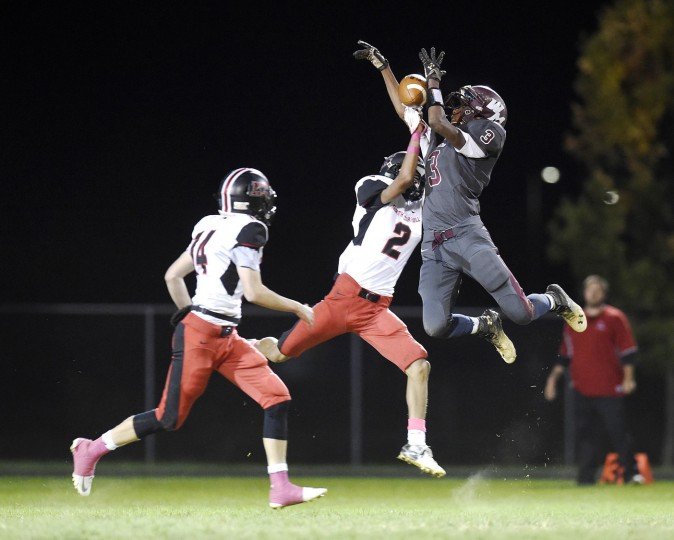 Winters Mill defensive back Dimeon Wright breaks up a pass intended for North Carroll wide receiver Aaron Nelson during the first half of their game in Westminster Friday, Oct. 16, 2015. at left is North Carroll's Connor Waskiewicz. (Dylan Slagle/Carroll County Times)