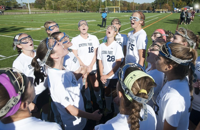Severna Park field hockey players cheer together before the start of their game with Broadneck. (Joshua McKerrow/Capital Gazette)
