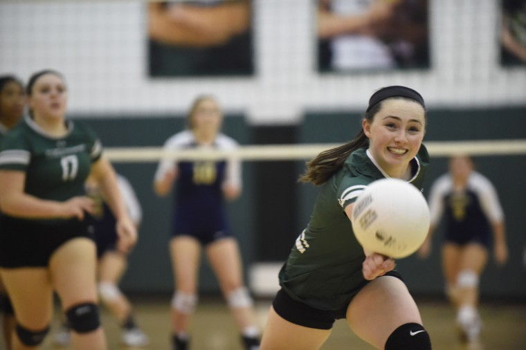 Glenelg Country's Jordan Daitch reaches out in an attempt to keep the ball off the floor against Chapelgate during a girls volleyball match at Glenelg Country School in Ellicott City on Wednesday, Oct 21. (Brian Krista/BSMG)