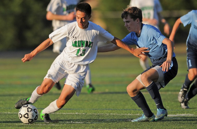 Arundel's Patrick Joyner prepares to pass off while South River's Mike Flanagan works for possession during Tuesday afternoons game held at Arundel High School. (Matthew Cole/Capital Gazette)