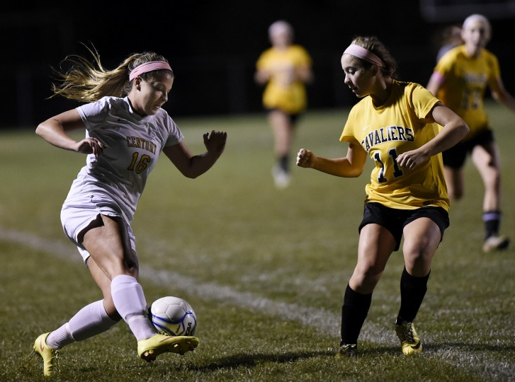 Century's Keri Mathias plays the ball up field in front of South Carroll's Susanna Willingham Tuesday, Oct. 20 in Eldersburg. (Dave Munch/Carroll County Times)