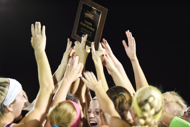Hereford teammates raises the championship plaque after defeating Dulaney 1-0 during the Baltimore County field hockey championship at Lansdowne High School on Thursday, Oct 22. (Brian Krista/BSMG)