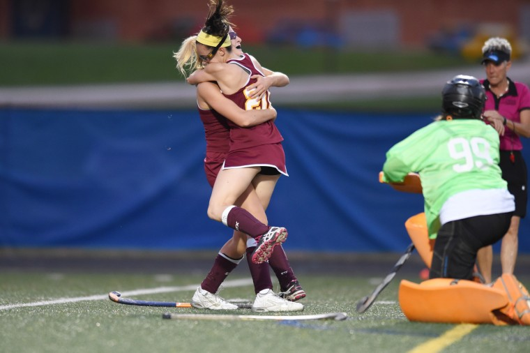 Hereford's Rachel Karwacki, left, is embraced by teammate Emma Reider after scoring a first half goal putting the Bulls up 1-0 against Dulaney during the Baltimore County field hockey championship at Lansdowne High School on Thursday, Oct 22. (Brian Krista/BSMG)