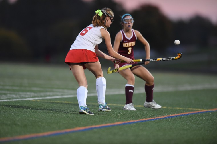 Dulaney's Claire Podles, left, looks to makes a move with the ball past Hereford's Meredith Joyce during the Baltimore County field hockey championship at Lansdowne High School on Thursday, Oct 22. (Brian Krista/BSMG)
