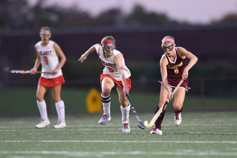 Hereford's Dana Meehling, right, moves the ball as Dulaney's Cristina Lopez tries to slow her progress during the Baltimore County field hockey championship at Lansdowne High School on Thursday, Oct 22. (Brian Krista/BSMG)