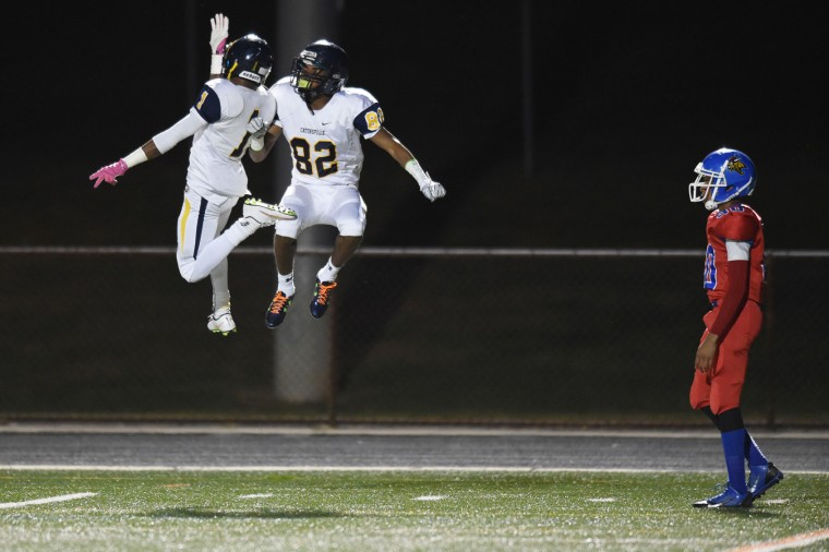 Catonsville's Malik Baker (82) celebrates his touchdown catch with teammate Jamal Johnson, left, during a football game at Lansdowne High School on Friday, Oct 23. (Brian Krista/BSMG)