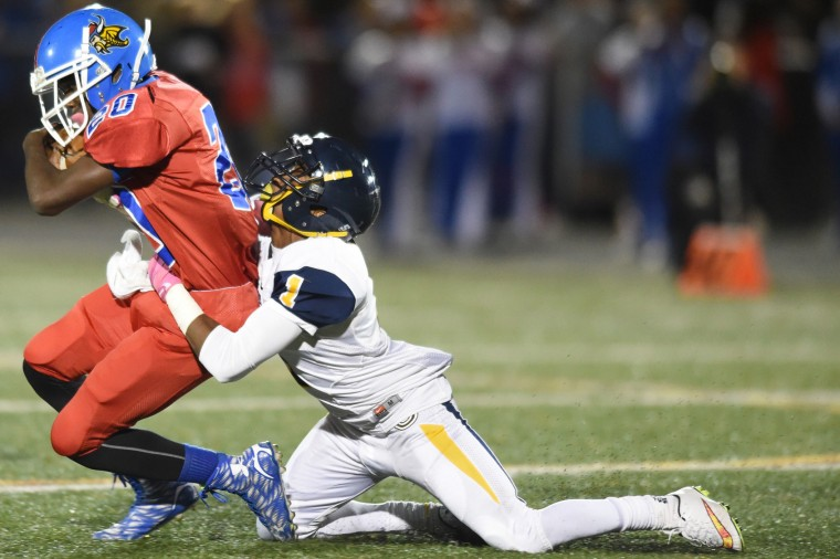 Catonsville's Jamal Johnson tries tackling Lansdowne running back Antoine Jones during a football game at Lansdowne High School on Friday, Oct 23. (Brian Krista/BSMG)