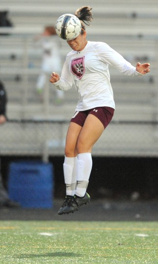 Broadneck's Hailey Small heads the ball during Thursday nights game against Old Mill held at Broadneck High School in Cape St. Claire. (Matthew Cole/Capital Gazette)