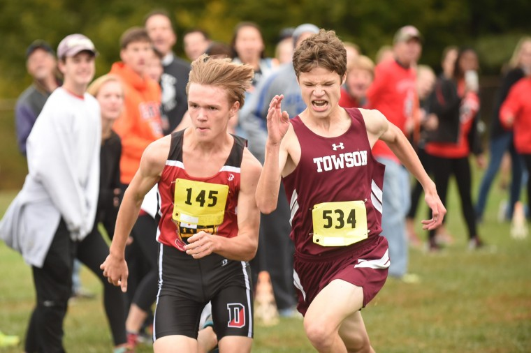 Dulaney's Matt Owens, left, and Towson's Vaughn Parts race to the finish line, finishing 5th and 6th respectively in the boys varsity section of the Baltimore County cross country championships at Dulaney High School on Saturday, Oct 24. (Brian Krista/BSMG)