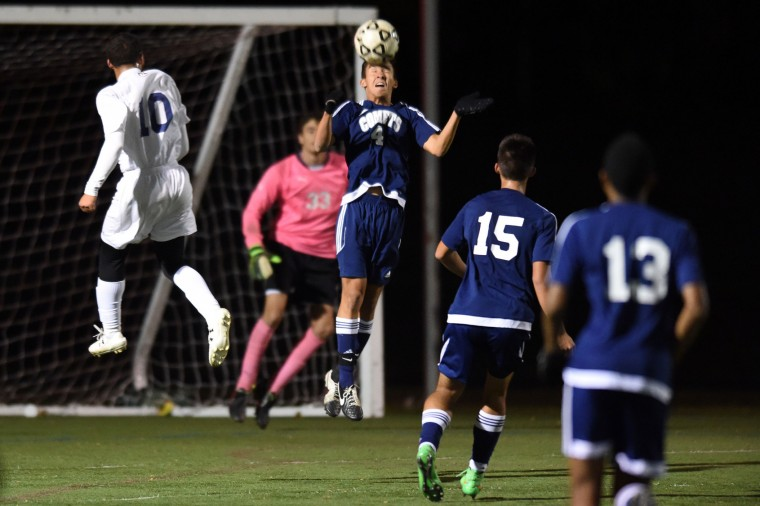 Catonsville defender Liam Llorin uses his head to clear the ball away from their goal against Perry Hall during the Baltimore County boys soccer championship game at Franklin High School in Reisterstown on Tuesday, Oct 27. (Brian Krista/BSMG)