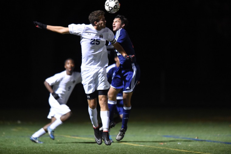 Perry Hall's Connor Gwin, left, and Catonsville's Matt Rehder both try to make a play on the ball during the Baltimore County boys soccer championship game at Franklin High School in Reisterstown on Tuesday, Oct 27. (Brian Krista/BSMG)
