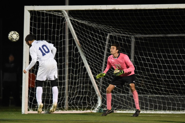 Catonsville goalie Eric Sheppard awaits a header from Perry Hall's Gaige Robinson that went wide of the goal during the Baltimore County boys soccer championship game at Franklin High School in Reisterstown on Tuesday, Oct 27.