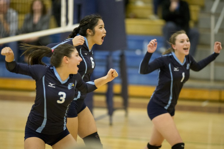 River Hill's Sammy Lala, left, Emily Luo and Brianna Davis react during the volleyball match against Glenelg at River Hill High School in Clarksville, MD on Tuesday, October 27, 2015. (Jen Rynda/BSMG)
