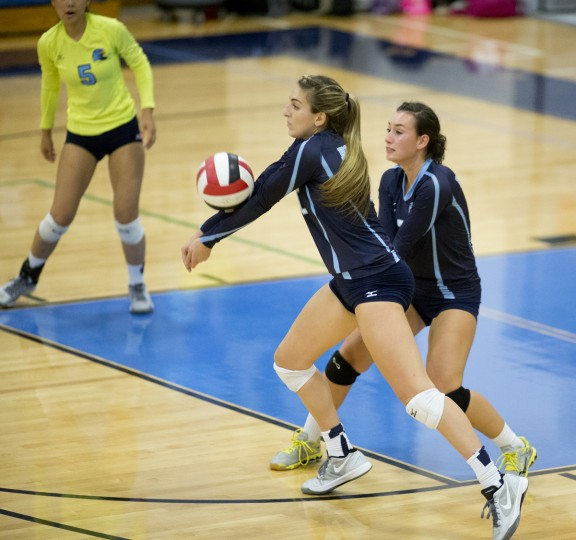 River Hill's Isabel Paci connects with the ball during the volleyball match against Glenelg at River Hill High School in Clarksville, MD on Tuesday, October 27, 2015. (Jen Rynda/BSMG)