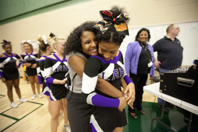 Long Reach head coach Nikkia Johnson gives senior captain Aisha Lucas a hug before her team performs during the Fall 2015 Howard County Varsity Cheerleading Competition at Atholton High School in Columbia, MD on Wednesday, October 28, 2015. (Jen Rynda/BSMG)