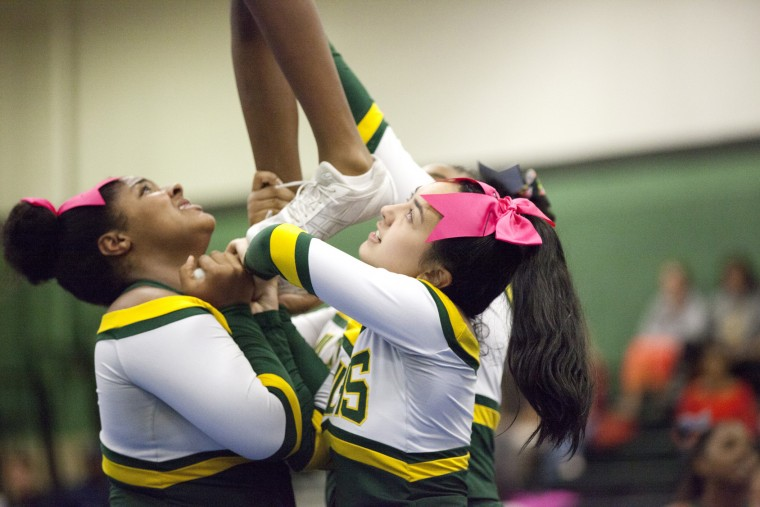Wilde Lake cheerleaders work together while they perform during the Fall 2015 Howard County Varsity Cheerleading Competition at Atholton High School in Columbia, MD on Wednesday, October 28, 2015. (Jen Rynda/BSMG)