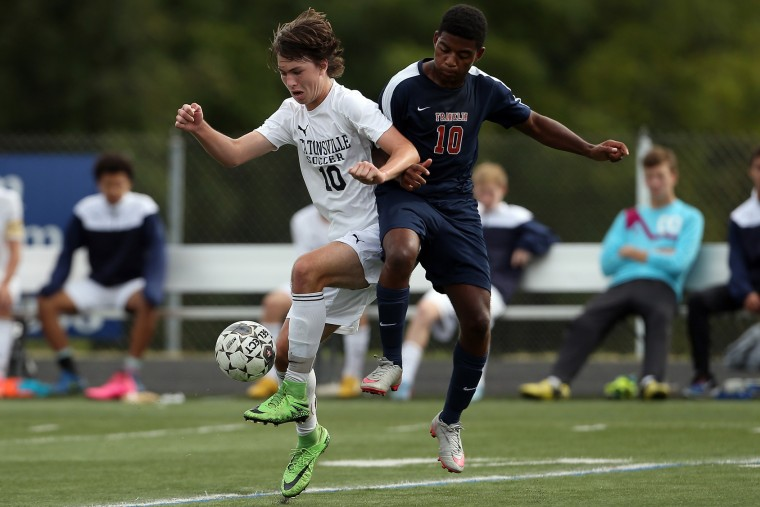 Luke Palmisano, left, of Catonsville tries to control the ball while Barazani Chiwengo of Franklin defends during a soccer game at Catonsville High School in Catonsville on Saturday, September 26, 2015. (Matt Hazlett/For BSMG)