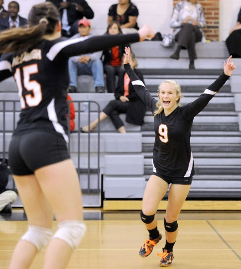 McDonogh's Sarah Dohler, left, and Hannah Rothe, right, celebrate after beating Roland Park in a high school volleyball match in Owings MIlls, Thursday, Oct. 1, 2015. McDonogh won the match 3-1. (Photo by Steve Ruark)
