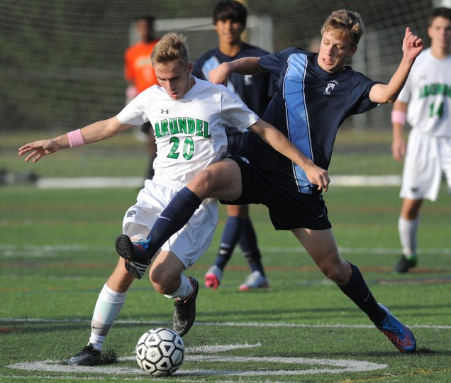 Chesapeake's Dominic Byerly attempts to take possession from Arundel's Andrew Wick during Tuesday afternoons game at Arundel High School. (Matthew Cole/Capital Gazette)