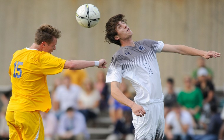Loyola's Danny Vinton, left, and Gilman's Dan DeSmit, jump for a ball in the first half of a high school soccer game in Roland Park, Friday, Oct. 9, 2015. (Photo by Steve Ruark)