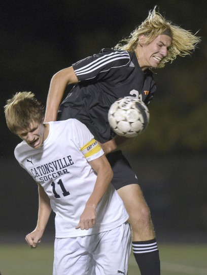 Catonsville's Jake Parrot, left, and Eastern Tech's Adam Wise vie for a ball in the first half of a high school soccer game, Tuesday, Oct. 13, 2015, in Catonsville. (Photo by Steve Ruark)