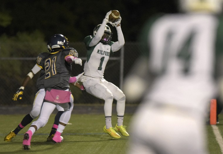 Milford Mill's Dana Jackson, #1, catches a touchdown pass in front of Catonsville's Rodney Henderson, #11, and Zaire Crosby, #21, in the first half of a high school football game, Thursday, Oct. 15, 2015, in Catonsville. (Steve Ruark/For BSMG)