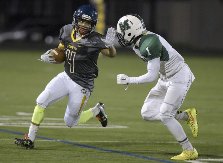 Catonsville's Raynard Minter, left, tries to run past Milford Mill's Dana Jackson in the first half of a high school football game, Thursday, Oct. 15, 2015, in Catonsville. (Steve Ruark/For BSMG)