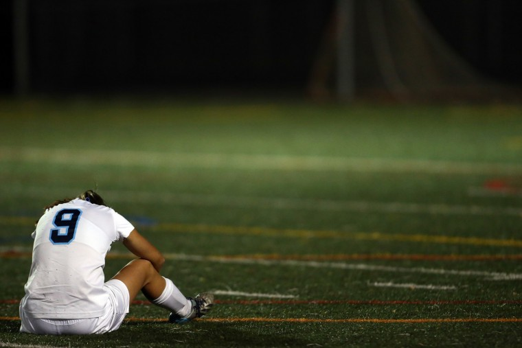 Ella Orzechowski of Howard sits on the turf after Reservoir wins in overtime during a soccer match at Howard High School in Ellicott City on Tuesday, October 20, 2015. (Matt Hazlett/For BSMG)