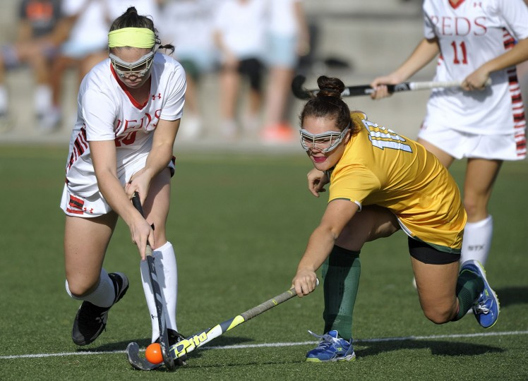 Roland Park's Mary Griffin, left, and Bryn Mawr's Sydney Stephenson vie for a ball in the first half of a high school field hockey game, Tuesday, Oct. 20, 2015, in Roland Park. (Steve Ruark/For BSMG)