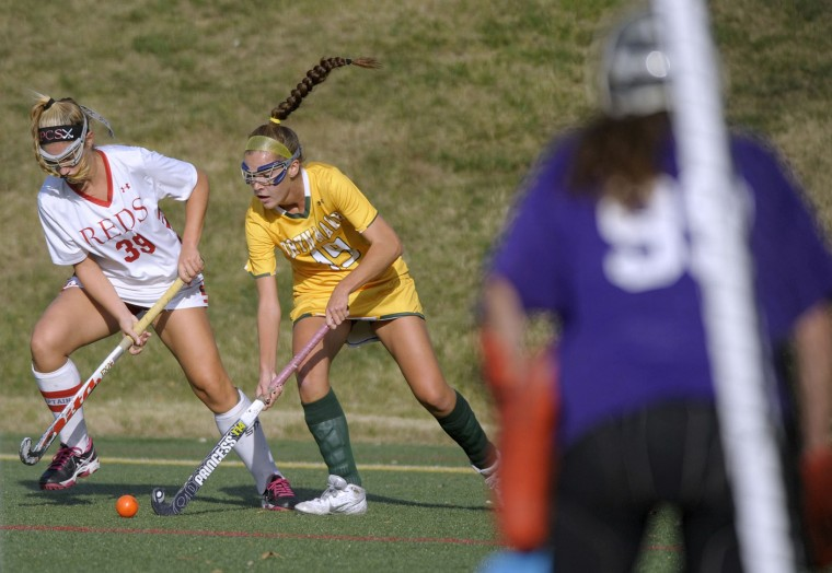 Roland Park's Emily Roebuck, left, defends Bryn Mawr's Mary Grace Box in the first half of a high school field hockey game, Tuesday, Oct. 20, 2015, in Roland Park. (Steve Ruark/For BSMG)
