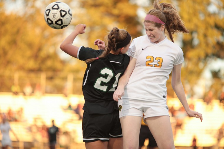 Atholton's #21 Kelley Flynn and Wilde Lake's #23 Sydney McNamara collide as they fight for control of the ball. Atholton Girls Varsity Soccer at Wilde Lake for the county championship, October 22, 2015. (Nate Pesce/For BSMG)