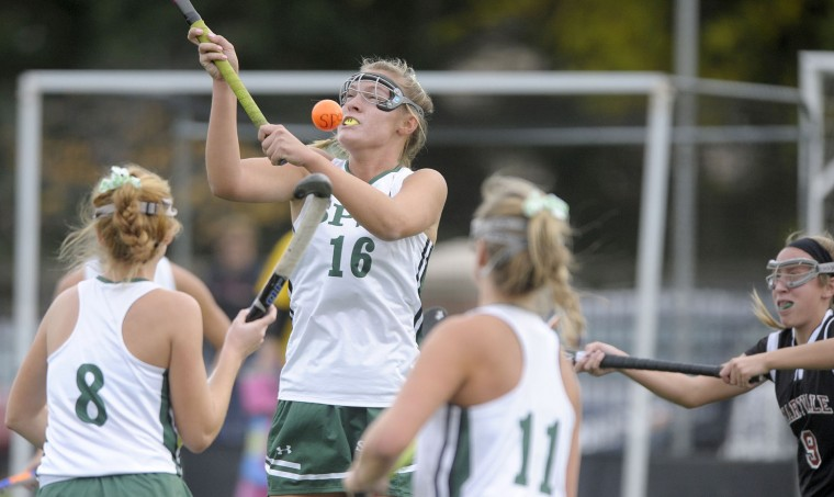 St. Paul's School for Girls' Paige Barton, #16, tries to control a ball as Maryvale's Olivia Cerasoli,#9, moves into the play in the first half of the IAAM B Conference semifinal field hockey game Thursday, Oct. 29, 2015 in Brooklandville. (Steve Ruark/For BSMG)