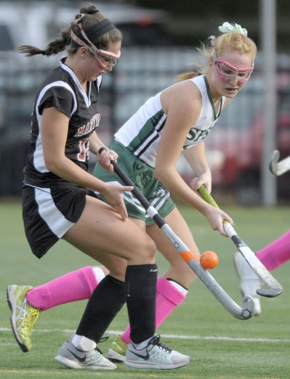 Maryvale's Ally Furnari, left, and St. Paul's School for Girls' Claire Gugerty vie for a ball in the first half of the IAAM B Conference semifinal field hockey game, Thursday, Oct. 29, 2015, in Brooklandville. (Steve Ruark/For BSMG)