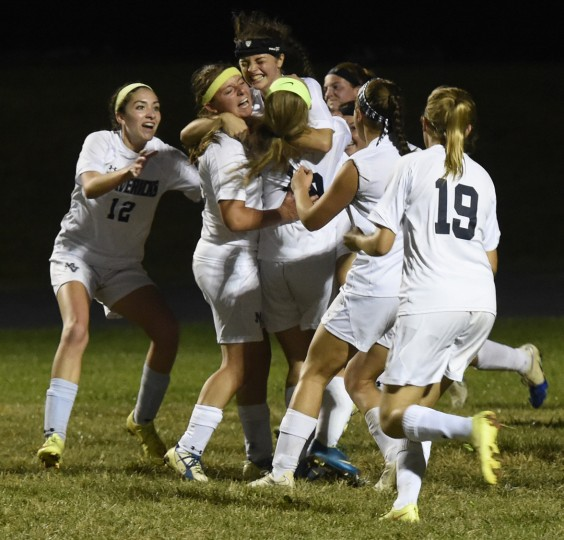 Manchester Valley celebrates a goal against Winters Mill Wednesday in Manchester. (Ken Koons/Carroll County Times)