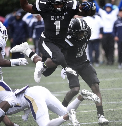 Gilman running back Dorian Maddox leaps over a Mount Saint Joseph defender as he heads toward the endzone, but can't stick the landing, falling a few yards short, during a football game at Gilman School in Roland Park, Baltimore, Friday, Oct. 2, 2015. (Jon Sham/Baltimore Sun)