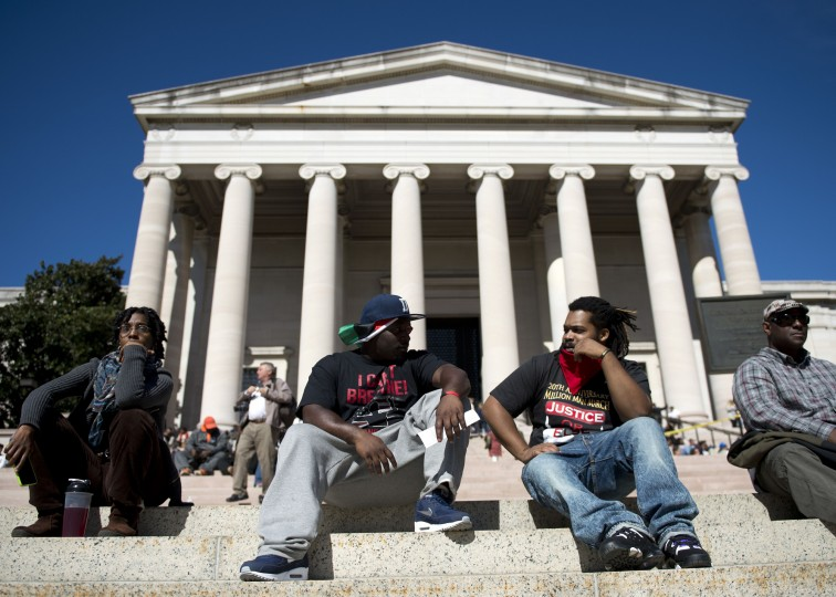 Two men rest on the steps of the National Art Gallery during the Justice or Else! rally on the National Mall in Washington, DC on October 10, 2015. The rally commemorates the 20th anniversary of the Million Man March which took place on October 16, 1995. (Andrew Caballero-Reynolds/AFP-Getty Images)