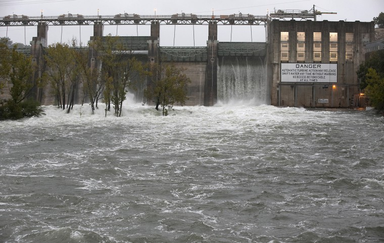 The Lower Colorado River Authority opened floodgates at Tom Miller Dam to relieve possible flooding on Lake Austin, Saturday, Oct. 24, 2015, in Austin, Texas. A powerful storm system moved through Texas on Saturday, flooding roads and causing a freight train to derail as parts of the state braced for the remnants of Hurricane Patricia to arrive. (Ralph Barrera/Austin American-Statesman via AP)
