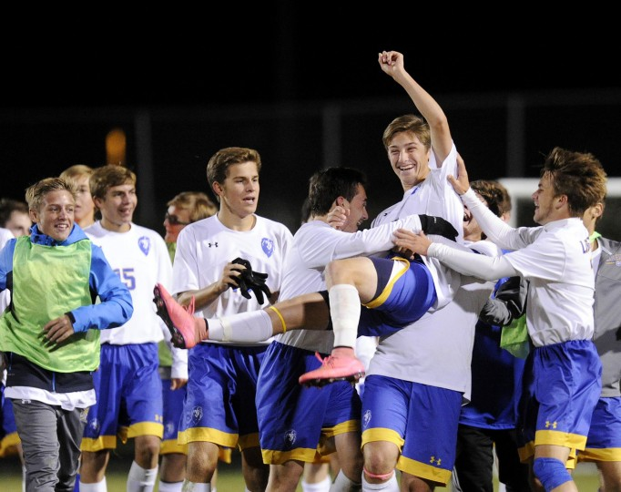 Liberty sophomore Quinn McLaughlin is hoisted up by his teammates as they celebrate their win over South Carroll in Eldersburg Monday, Oct. 26, 2015. McLauglin scored the lone point of the game. (Dylan Slagle/Carroll County Times)