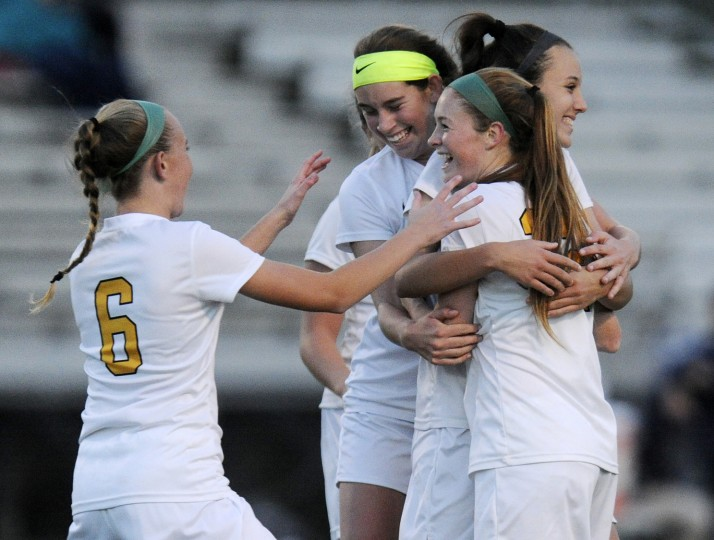 Century's Maddie Hart, second from right, celebrates with teammates Julia Hatmaker, Lisi Hurst and Kelsey Morrison, left, after scoring a goal in the second half of their win over Manchester Valley in Eldersburg Monday, Oct. 26, 2015. (Dylan Slagle/Carroll County Times)