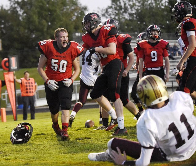 Linebacker William Hastings celebrates after dropping Brunswick's Dylan deSimon in the end zone for a safety during the first half of the Panthers' 30-0 win over the Railroaders in Hampstead Monday, Oct. 5, 2015. (Dylan Slagle/Carroll County Times)