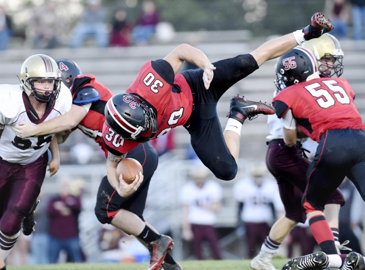 North Carroll running back Tyler Przybilski vaults Brunswick defenders during the first half of the Panthers' Monday night game in Hampstead Oct. 5, 2015. (Dylan Slagle/Carroll County Times)
