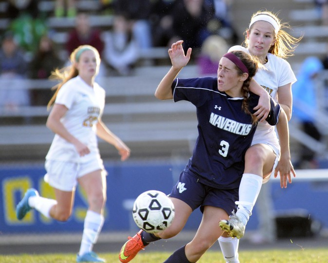 Manchester Valley's Lizzie Colson and Century's Megan Callan vie for the ball during the first half of their game in Eldersburg Monday, Oct. 26, 2015. (Dylan Slagle/Carroll County Times)