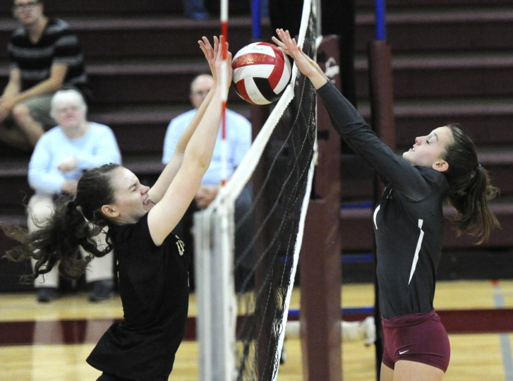 South Carroll's Malia Henry and Winters Mill's Brynn Choplin meet at the net. (Ken Koons/Carroll County Times)